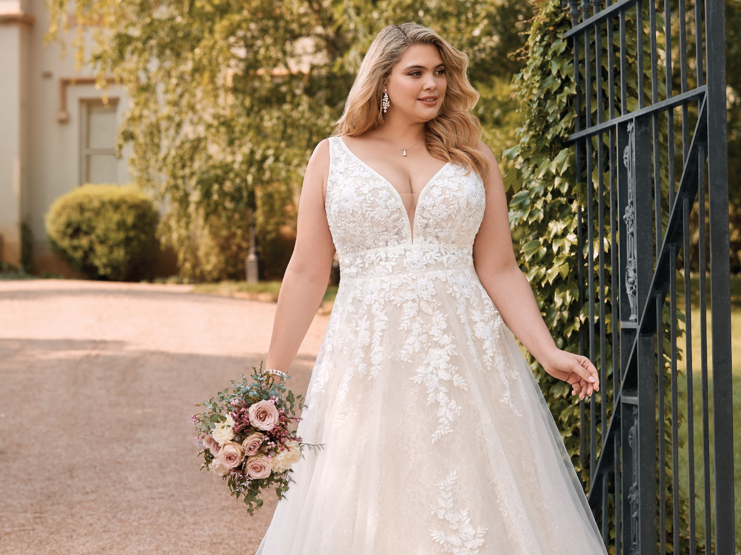 Plus size model in white Sophia Tolli dress