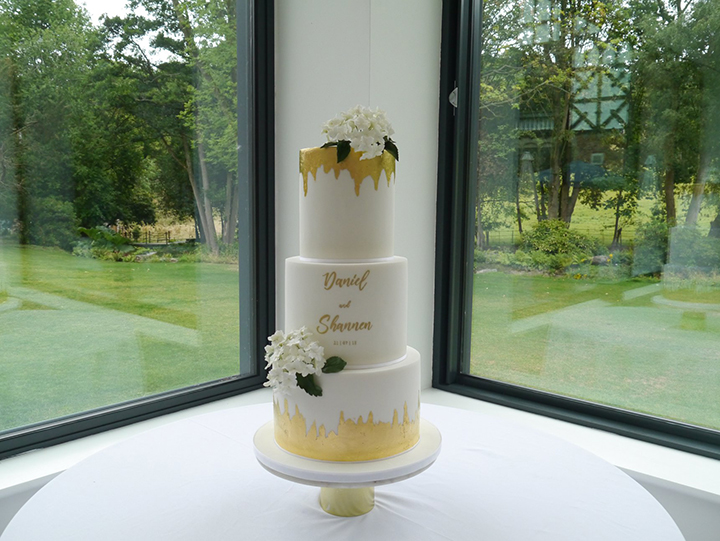 Contemporary White Wedding Cake With Hand-Painted Calligraphy & Gold Leaf